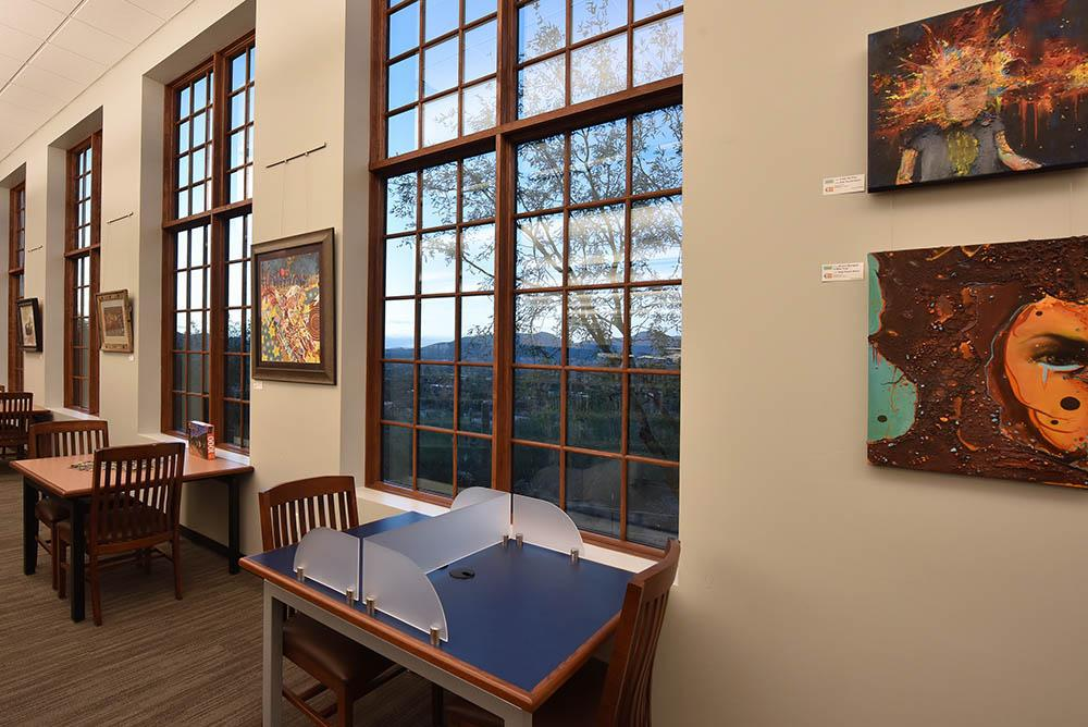 library reading nook with art