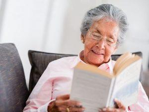 elderly women reading home delivery book