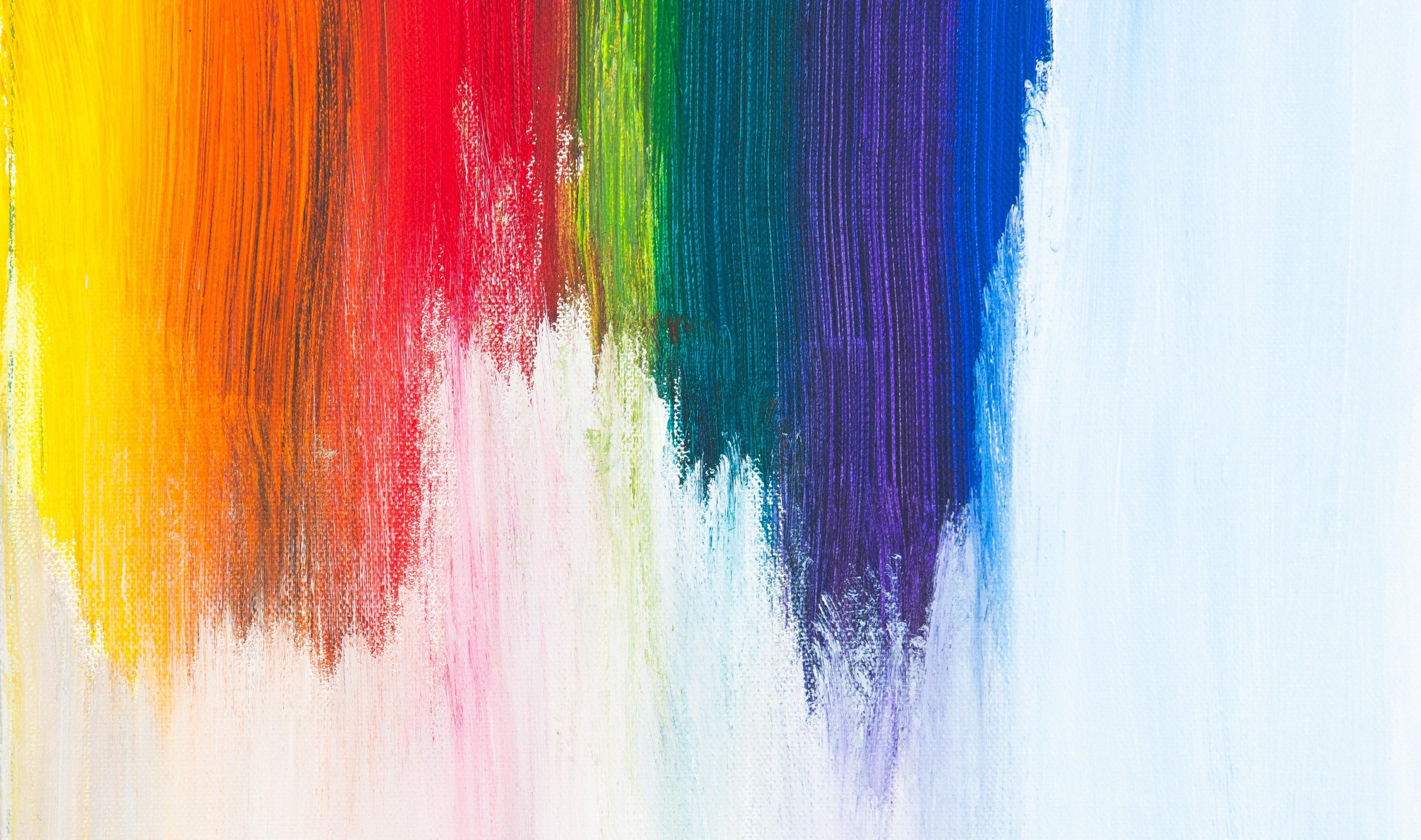 stripes of yellow, red, green, blue and purple paint on a white background