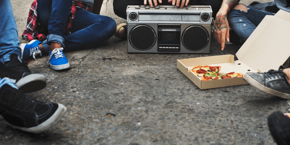 teens with pizza a boom box