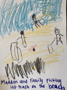 Crayon drawing of Madden and his family cleaning the beach